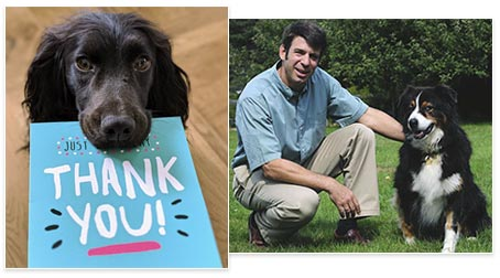 Happy dog with a thank you card
